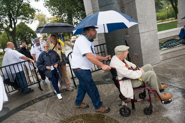 World War II Veterans Elizabeth Dupont and Edward Murphy enter the World War II memorial Saturday October 12, 1013 in Washington, DC.  (Lisa Helfert/Special to the Las Vegas Review-Journal)