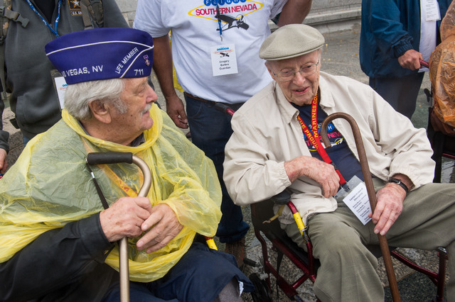 World War II Veterans Richard R. Stein from Henderson, Nevada and Edward Murphy from Las Vegas, Nevada talk before a group photo is taken at the World War II Memorial Saturday October 12, 2013 in  ...