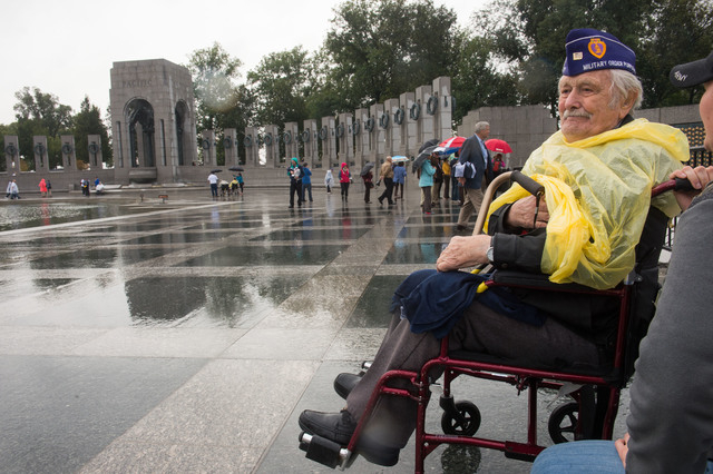 World War II Veteran Richard Stein of Henderson, Nevada and Tina Podskalan talk during visit at the World War II memorial Saturday October 12, 2013 in Washington, DC. (Lisa Helfert/Special to the  ...