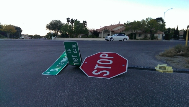 A traffic sign was felled by wind Tuesday at Durango Drive and Hammer Lane in northwest Las Vegas. (Jeff Mosier/Las Vegas Review-Journal)