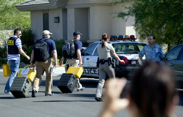Drug Enforcement Administration agents arrive at the home of Dr. Conrad Murray in Red Rock Country Club on Tuesday, July 28, 2009, as they move forward with their investigation into the death of p ...