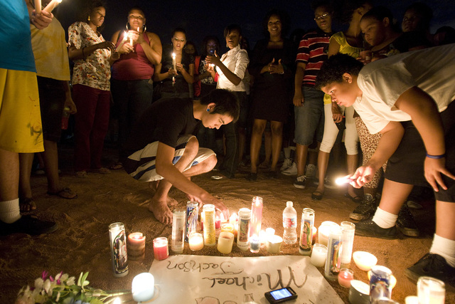 Fans of pop superstar Michael Jackson attend an impromptu candlelight vigil on Thursday, June 25, 2009, in Las Vegas. Jackson reportedly died of an apparent heart attack earlier in the day. (File, ...