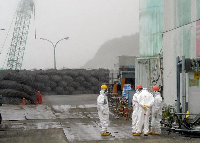 Workers are shown at the Fukushima Dai-ichi nuclear plant at Okuma in Fukushima prefecture, Japan in June 12. After a 7.3-magnitude earthquake struck Japan Saturday morning, Tokyo Electric Power C ...