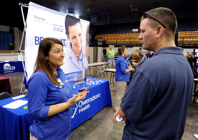 Registered nurse Salanda Bowman, left, talks with part-time Kentucky Wesleyan College student Jason Ward about job openings at the Owensboro Health Regional Hospital during a Regional Career and J ...