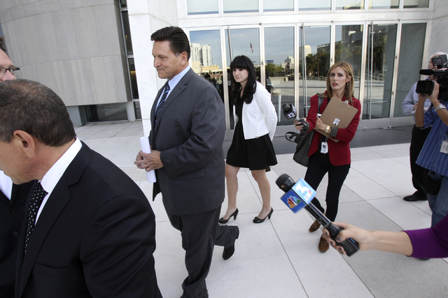 Longtime Family Court Judge Steven Jones, third from left, declines to talk to the news media Thursday, Nov. 1, 2012, outside the Lloyd George Federal Courthouse in Las Vegas after pleading not gu ...