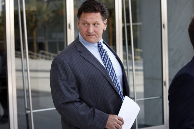 Longtime Family Court Judge Steven Jones, exits the Lloyd George Federal Courthouse Thursday, Nov. 1, 2012, after pleading not guilty to a slew of felony charges. (K.M. Cannon/Las Vegas Review-Jou ...