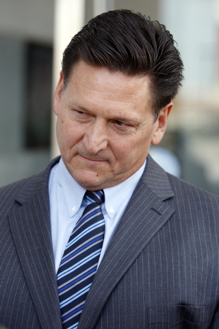 Longtime Family Court Judge Steven Jones looks on as his attorney Robert Draskovich, not shown, talks to the news media Thursday, Nov. 1, 2012, outside the Lloyd George Federal Courthouse in Las V ...