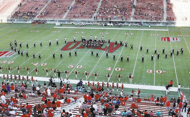 """UNLV's marching band lines up in the shape of the """"Hey Reb"""" mascot's mustache at the Rebels' 38-7 win over Western Illinois at Sam Boyd Stadium on Sept. 21. (Jason Bean/Las Vegas Review- ..."""