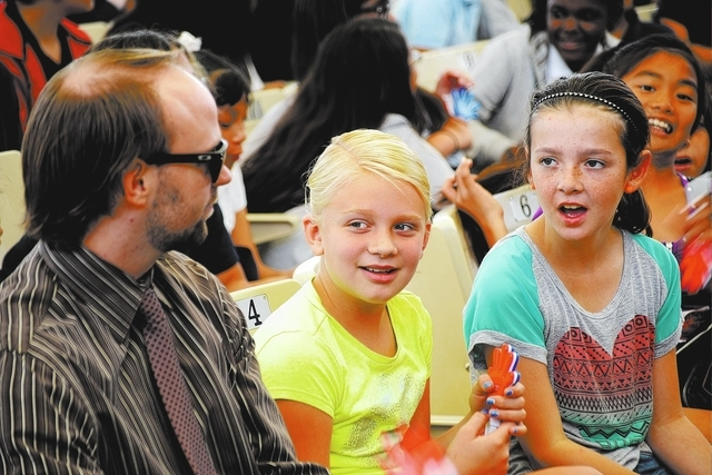 Newton Elementary teacher Nathan Carney, left, chats with Grace Lamoreaux, center, and Hanah Jones before the debates at KidsVention 2013 at the Henderson Pavilion Wednesday, Oct. 23, 2013. Studen ...