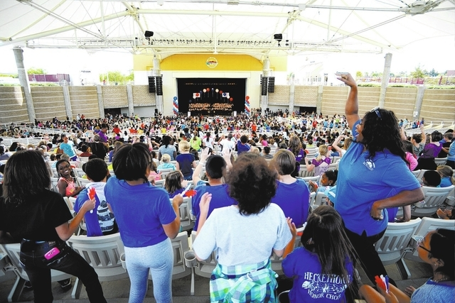 Heckethorn Elementary school teacher, Donna Simms, right, leads her students in song and cheers during KidsVention 2013 at the Henderson Pavilion Wednesday, Oct. 23, 2013. Students from 16 Clark C ...