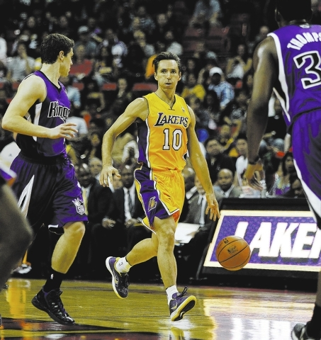 Steve Nash (10) of the Los Angeles Lakers brings the ball up court against the Sacramento Kings during a NBA preseason game at the Thomas and Mack Center in Las Vegas on Oct. 19, 2012. (Jason Bean ...