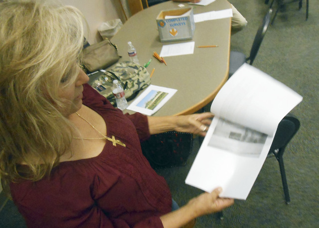 Northwest resident Kelly Griffith shows a proposal for two 40-foot horse arenas that she would like to be built at Lone Mountain Park. She said developers put up walls, restricting where horses ca ...