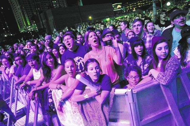 Fans watch Imagine Dragons perform during the Life is Beautiful festival in Las Vegas Saturday, Oct. 26, 2013. (John Locher/Las Vegas Review-Journal)