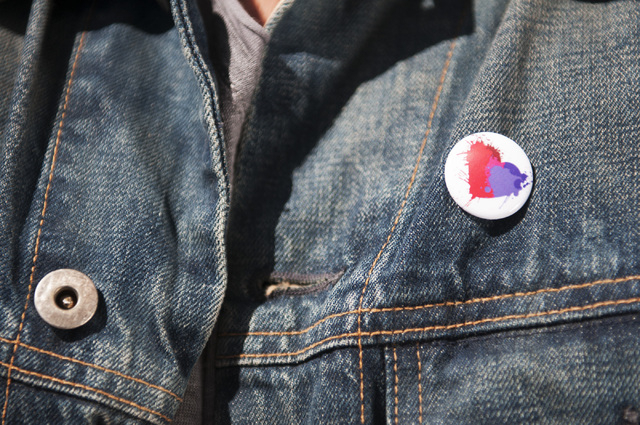 Rehan Choudhry, founder of Life is Beautiful Festival, is seen wearing a button with the festival's logo on his jacket, Saturday, Sept. 21, 2013, in Las Vegas, Nev. The festival is scheduled to ta ...