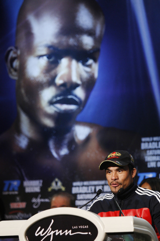 Boxer Juan Manuel Marquez speaks during the pre-fight press conference for his fight against Timothy Bradley at the Wynn Las Vegas on Oct. 9, 2013. (Jason Bean/Las Vegas Review-Journal)