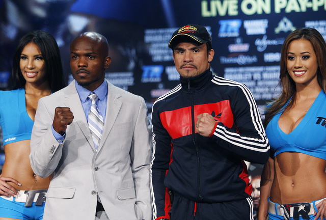 Boxers Juan Manuel Marquez, right, and Timothy Bradley pose during their pre-fight press conference at the Wynn Las Vegas on Oct. 9, 2013. (Jason Bean/Las Vegas Review-Journal)