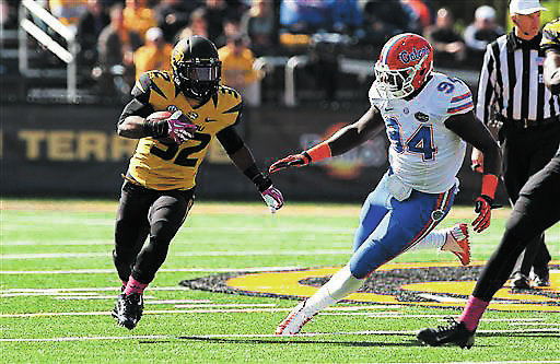 Missouri running back Russell Hansbrough tries to get past Florida defensive lineman Bryan Cox Jr. during the Tigers' 36-17 victory last Saturday at Columbia, Mo. Fifth-ranked Missouri is 7-0 he ...