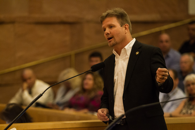 Chris Collins, executive director of the Las Vegas Police Protective Association, speaks in support of raising the sales tax during a hearing Tuesday. (Chase Stevens/Las Vegas Review-Journal)