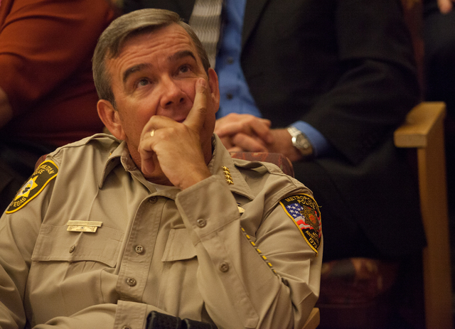 Clark County Sheriff Doug Gillespie looks at a monitor displaying a lack of sufficient votes from the Clark County Commission to raise the sales tax on Tuesday. (Chase Stevens/Las Vegas Review-Jou ...