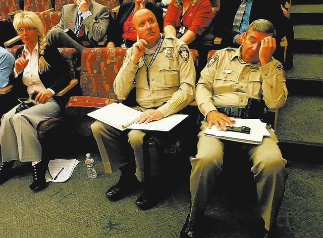 Clark County Sheriff Douglas Gillespie, right, and Clark County Undersheriff Jim Dixon react to a vote Tuesday when the Clark County Commission voted down sales tax proposals to pay for more polic ...