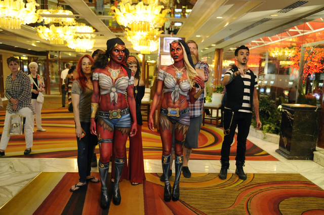 "Kelly ""Red"" Belmonte, left, walks with Heather Aguilera, Drew Maverick and Nicholas ""Nix"" Herrera. (David Becker/Syfy)"