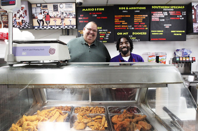Mario Berlanger, left, and cook Kenyada Fitzgerald, Sr.,  pose at Mario's Westside Market in Las Vegas, Wednesday, Sept. 25, 2013. Mario's provides southern and Soul Food for African-Americans in  ...