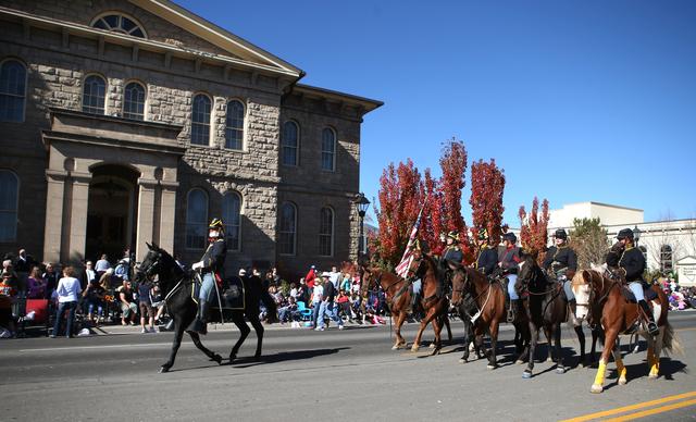 The 1st Nevada Cavalry participates in the 75th annual Nevada Day parade in Carson City, Nev., on Saturday, Oct. 26, 2013. (Cathleen Allison/Las Vegas Review-Journal)