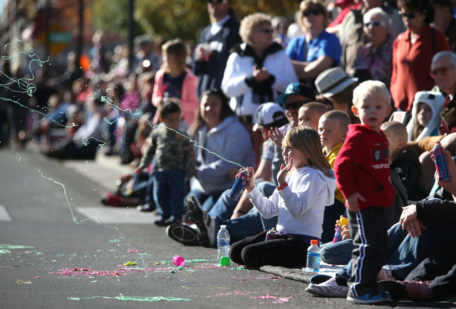 Rachael Curtis, 7, shoots silly string at passing floats during the 75th annual Nevada Day parade in Carson City, Nev., on Saturday, Oct. 26, 2013. (Cathleen Allison/Las Vegas Review-Journal)