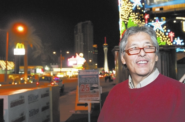 Eddie Munoz, owner of Strip Advertising, poses for a photograph at Las Vegas Boulevard on the Strip in Las Vegas, Thursday, Oct. 24, 2013. An ordinance is being considered by Clark County that wou ...