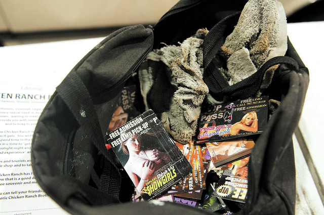 A bag belonging to Eddie Munoz, owner of Strip Advertising, is seen storing advertising fliers and business cards used to refill their news racks on Las Vegas Boulevard in Las Vegas, Thursday, Oct ...