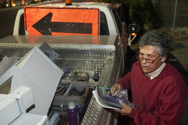 Eddie Munoz, owner of Strip Advertising, grabs magazines from his truck to refill news racks located on Las Vegas Boulevard near Circus Circus Hotel in Las Vegas, Thursday, Oct. 24, 2013. An ordin ...