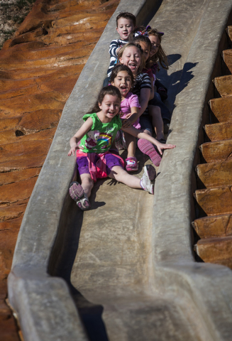 Kids ride down a concrete slide at  North Las Vegas Craig Ranch Regional Park, Friday, Oct. 25, 2013. The $130 million 170-acre park open today. It will cost  cash strapped North Las Vegas $2 mill ...