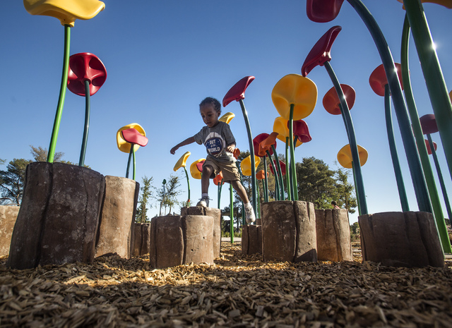 Gabriel Henry, 4, plays on concrete stumps at  North Las Vegas Craig Ranch Regional Park, Friday, Oct. 25, 2013. The $130 million 170-acre park open today. It will cost  cash strapped North Las Ve ...