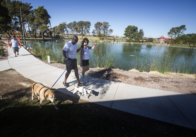 Robert and Tanya Clinkscales walk their dogs Gordie, Charlie and Holly at  North Las Vegas Craig Ranch Regional Park, Friday, Oct. 25, 2013. The $130 million 170-acre park open today. It will cost ...
