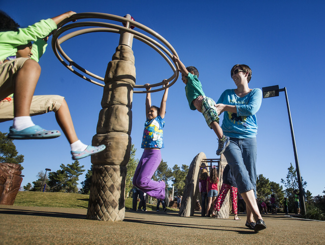 Jessica Franklin plays with her son Chandler, 2 in the Adventure Playgroun at  North Las Vegas Craig Ranch Regional Park, Friday, Oct. 25, 2013. The $130 million 170-acre park open today. It will  ...