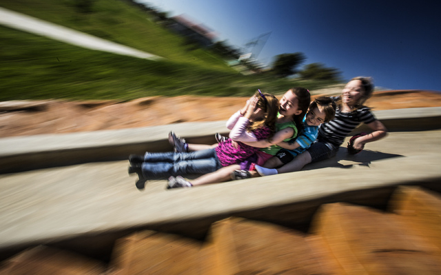 Girls ride down a concrete slide at  North Las Vegas Craig Ranch Regional Park, Friday, Oct. 25, 2013. The $130 million 170-acre park open today. It will cost  cash strapped North Las Vegas $2 mil ...