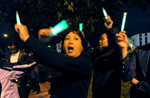 Registered nurse Marissa Gutierrez chants during a candlelight vigil outside MountainView Hospital on Tuesday, Oct. 29, 2013. About two dozen nurses voiced their concerns with staffing issues and  ...