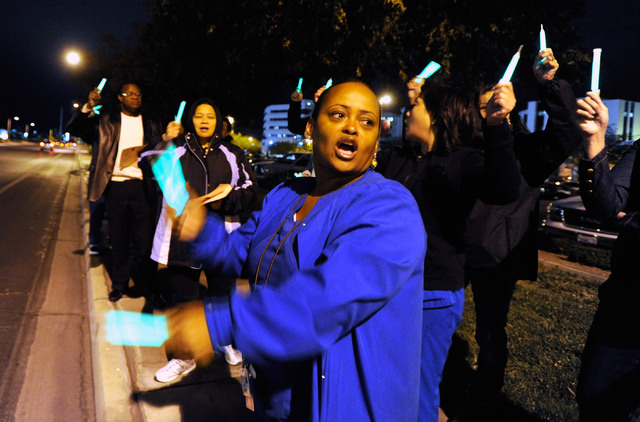 Registered nurse Diane Lew chants during a candlelight vigil outside MountainView Hospital on Tuesday, Oct. 29, 2013. About two dozen nurses voiced their concerns with staffing issues and to deman ...