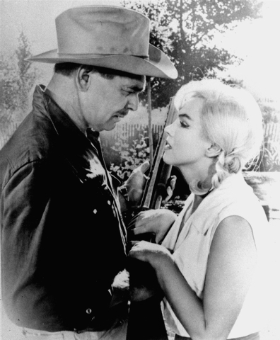 """Clark Gable and Marilyn Monroe, play a scene in """"The Misfits"""" in this undated file photo. It turned out to be the last movie for both in 1961. (AP Photo, file)"""