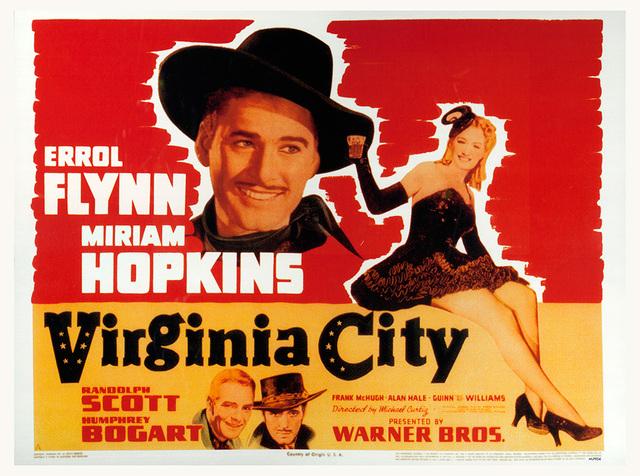 "Poster for the Warner Bros. film, ""Virginia City"" (1940) starring Errol Flynn, Miriam Hopkins, Randolph Scott and Humphrey Bogart. (Courtesy Warner Bros.)"