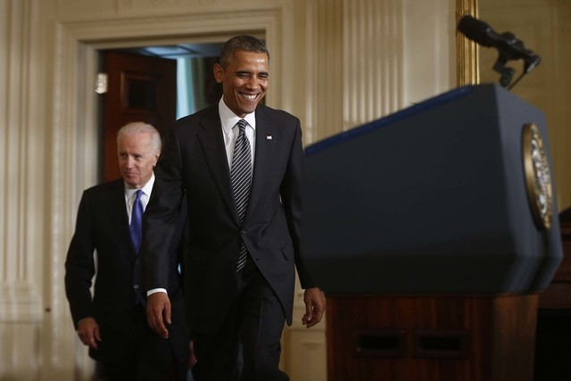 President Barack Obama and Vice President Joe Biden arrive in the East Room of the White House in Washington, Thursday, Oct. 24, 2013. Obama said with the partial government shutdown over, Republi ...