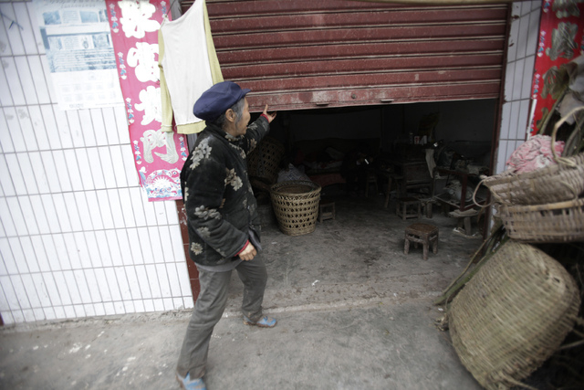 Kuang Shiying, daughter-in-law of Zhang Zefang, a 94-year-old woman who sued her own children for not taking care of her, rolls open the rusted metal doors at her home to see Zhang in Fusheng Vill ...