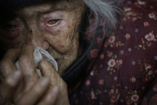 Zhang Zefang, 94, who sued her own children for not taking care of her, cries as she describes the miseries she has endured throughout her life, at Fusheng Village, east of Chongqing City, China,  ...