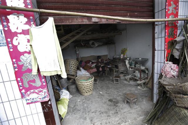 Zhang Zefang, a 94-year-old woman who sued her own children for not taking care of her, sits on her bed at her home in Fusheng Village, east of Chongqing City, China on March 19, 2013. Zhang is am ...