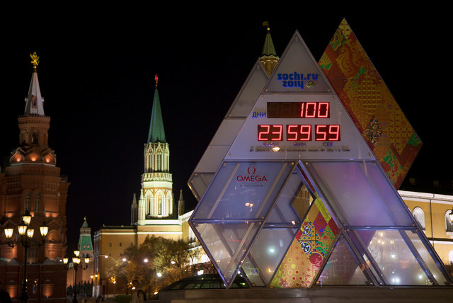 The countdown clock showing 100 days left until the start of 2014 Winter Olympic Games is on display at Manezhnaya square, with Kremlin wall and towers at the background, in downtown Moscow, Russi ...