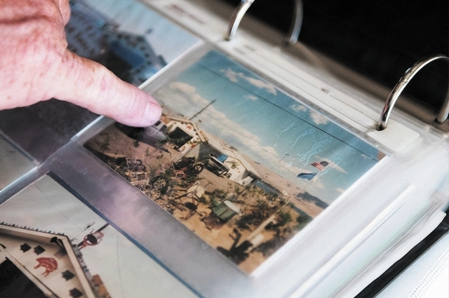 Bob Hitchcock, is seen pointing at a photo of the house he owns at Stewart's Point in Lake Mead National Recreation Area, Saturday, Oct. 5, 2013, in Las Vegas, Nev. Hitchcock was ordered to leave  ...