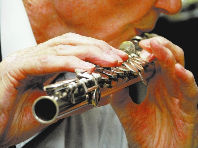 Flutist Roger Hall takes part in a jam session at local musician Jim Hemming's home. (F. Andrew Taylor/View)