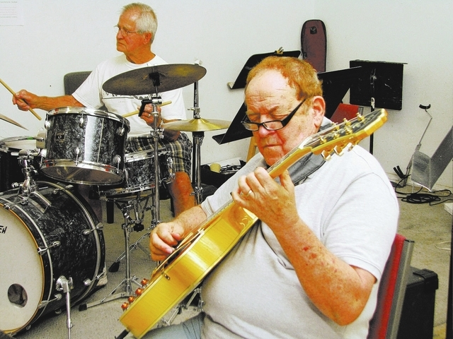 Drummer Howie Agster and guitarist Tom McDermott take part in a jam session at Jim Hemming's home. (F. Andrew Taylor/View)
