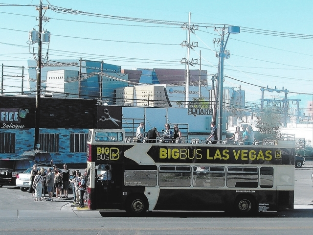 Las Vegas Valley residents visit Art Square, 1025 S. First St., during the Happy Hour Bus Tour, part of Rediscover Downtown Day, Sept. 28. The bus also visited Main Street design shops in the Frem ...
