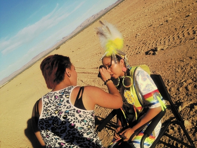 Jariselle Marie Cortijo ( make-up) with Shayna Mirabal (young lady with the yellow feathers). (Moapa River Indian Reservation northeast of Las Vegas)